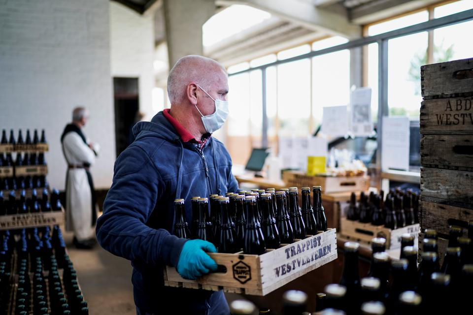 An employee at the Saint-Sixtus abbey shop, in Westvleteren, on May 14, 2020 as the trappist monks resume selling their beer.