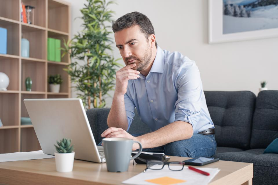 man working from home trying to do online job interview