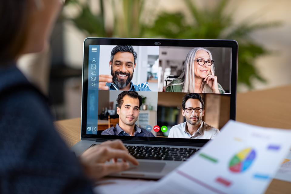 Group of businessmen and businesswomen smart working from home on video call.