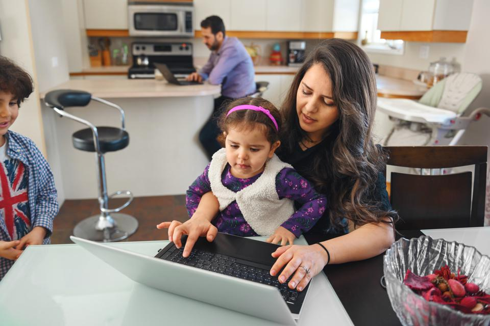Quarantined family telecommuting with kids