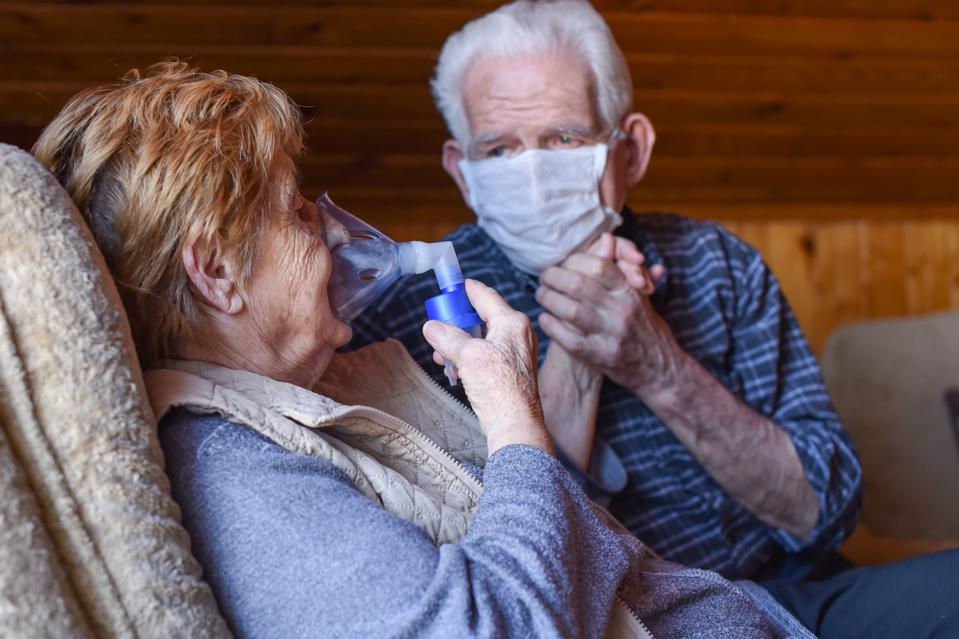 Old Couple in love with respiratory system and mask care for each other