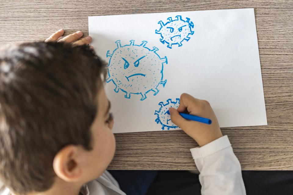 Little kid drawing a coronavirus