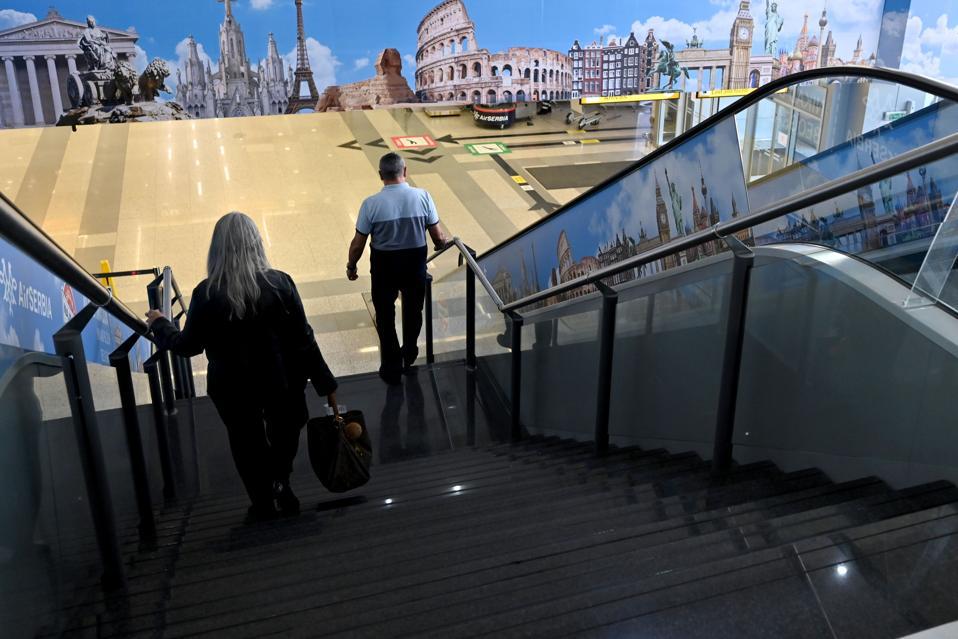 travelers at Belgrade airport in Serbia as flights resume to US america overseas