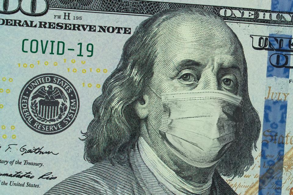 COVID-19 coronavirus in USA. American banknote