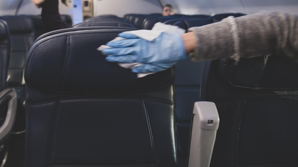 Disinfection of aircraft seats by passengers after boarding the flight