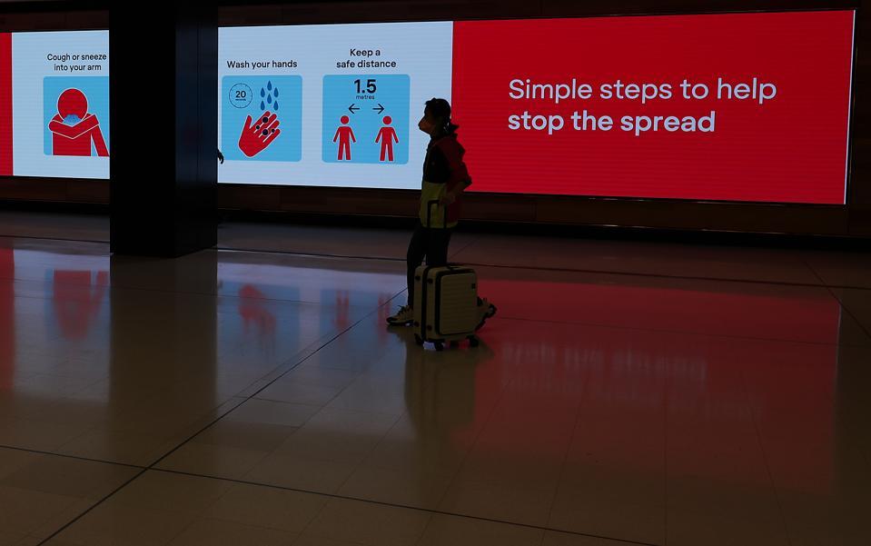 Australian travel ban Coronavirus Sydney airport social distancing airlines