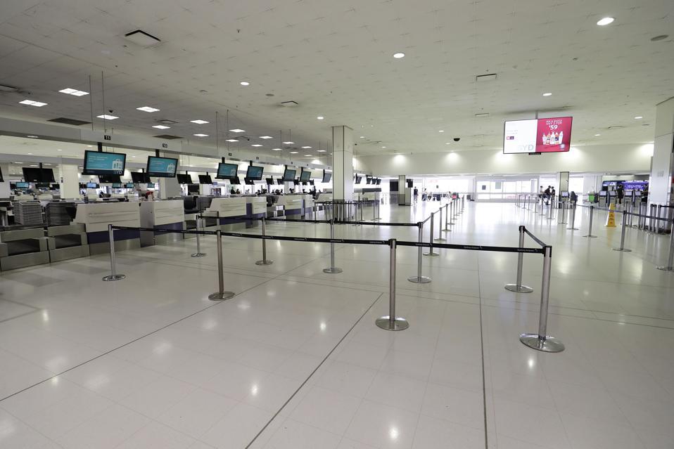 Australia Coronavirus Pandemic Sydney airport social distancing not onboard