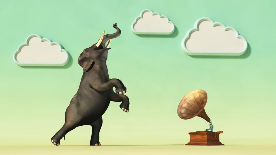 Elephant dancing in front of an old gramophone . This is a 3d render illustration .