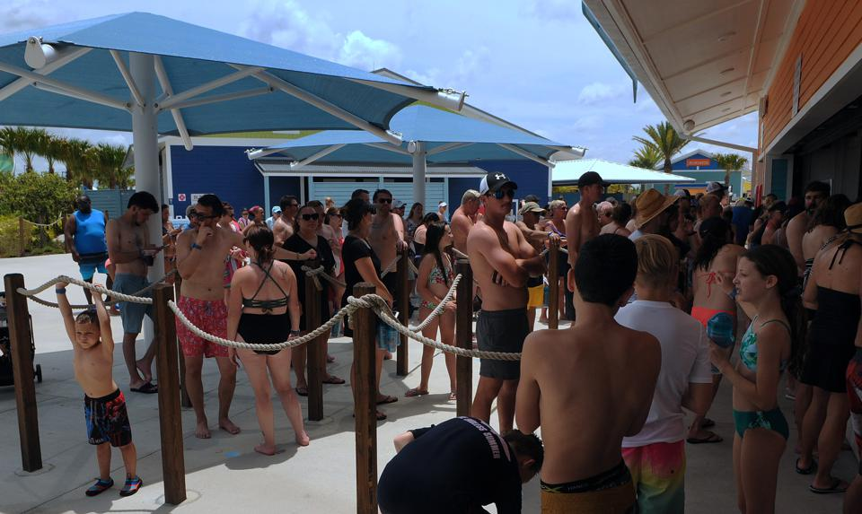 People wait in a queue at a snack bar at Island H2O Live!...