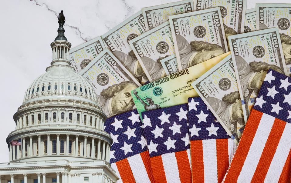 Financial a stimulus bill individual checks from government US 100 dollar bills currency American flag Global pandemic Covid 19 lockdown