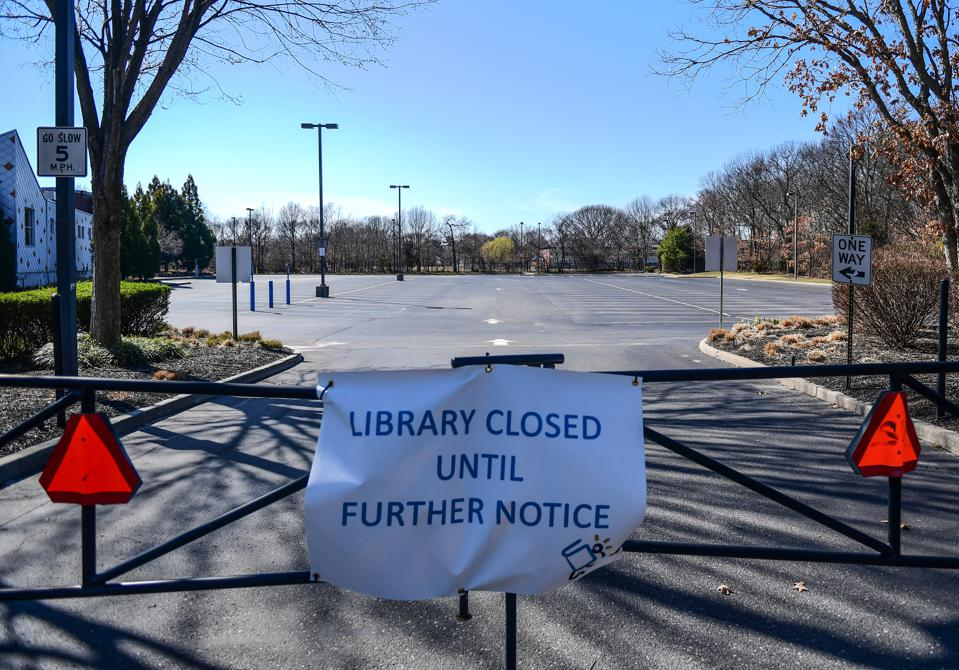 Sign says library is closed until further notice during pandemic