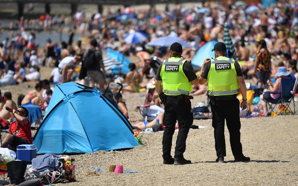 Beach goers in England after lockdown restrictions were eased.
