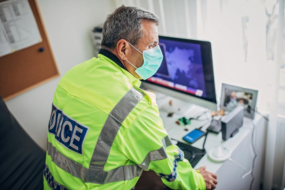 British police officer in the office