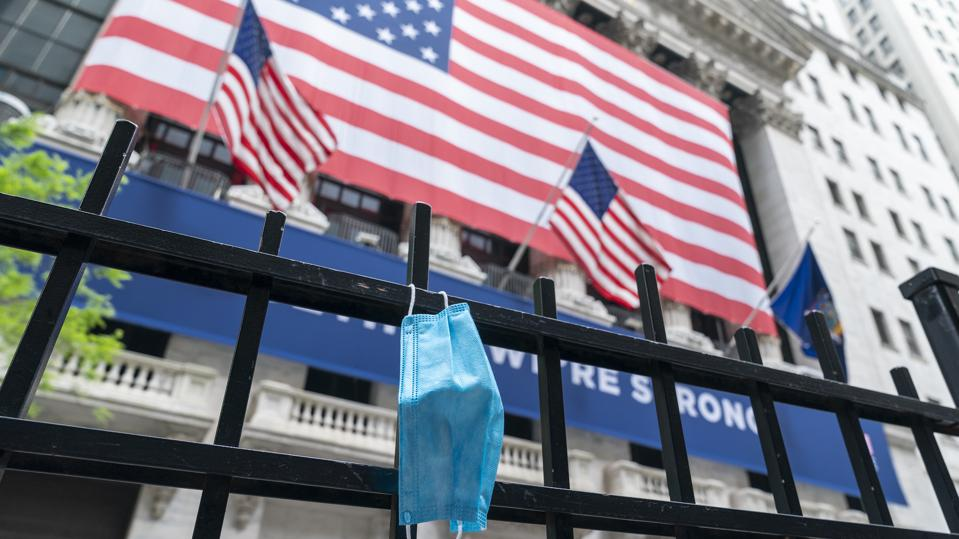 Facial mask seen on the fence of New York Stock Exchange on...
