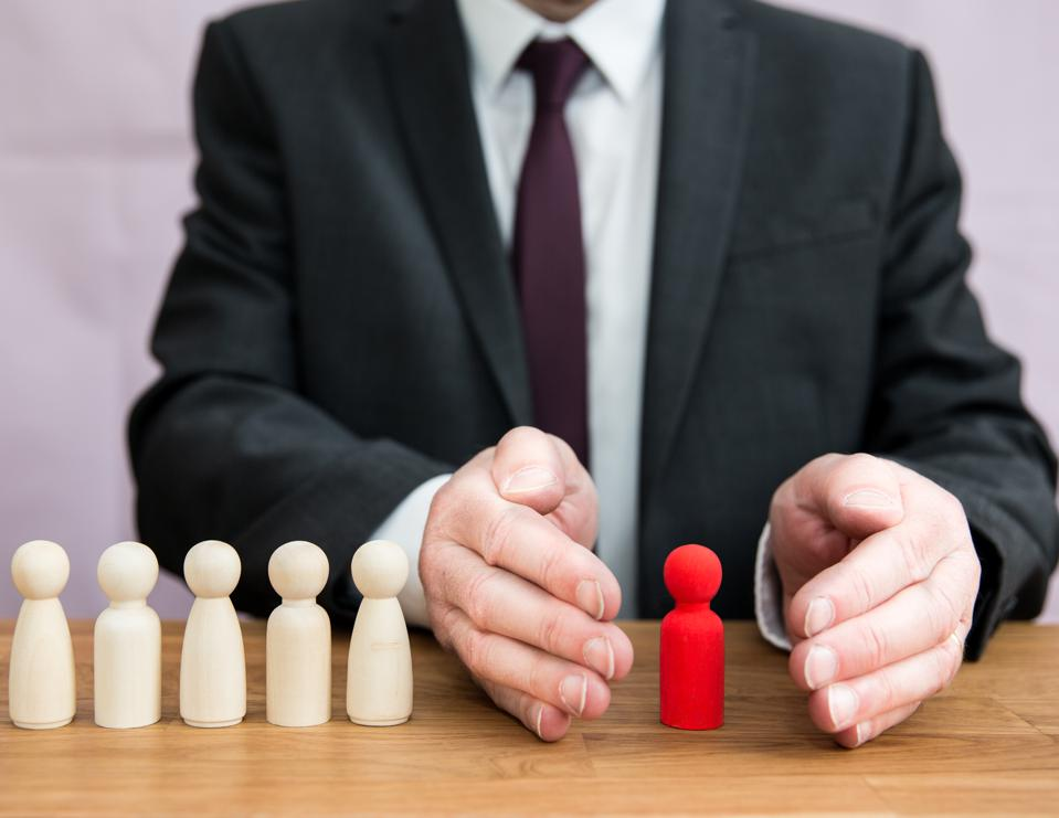 A worker or employee being shielded and protected by a manager or employer