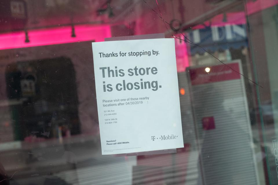 A notice seen hanging at a T-Mobile store announcing its...