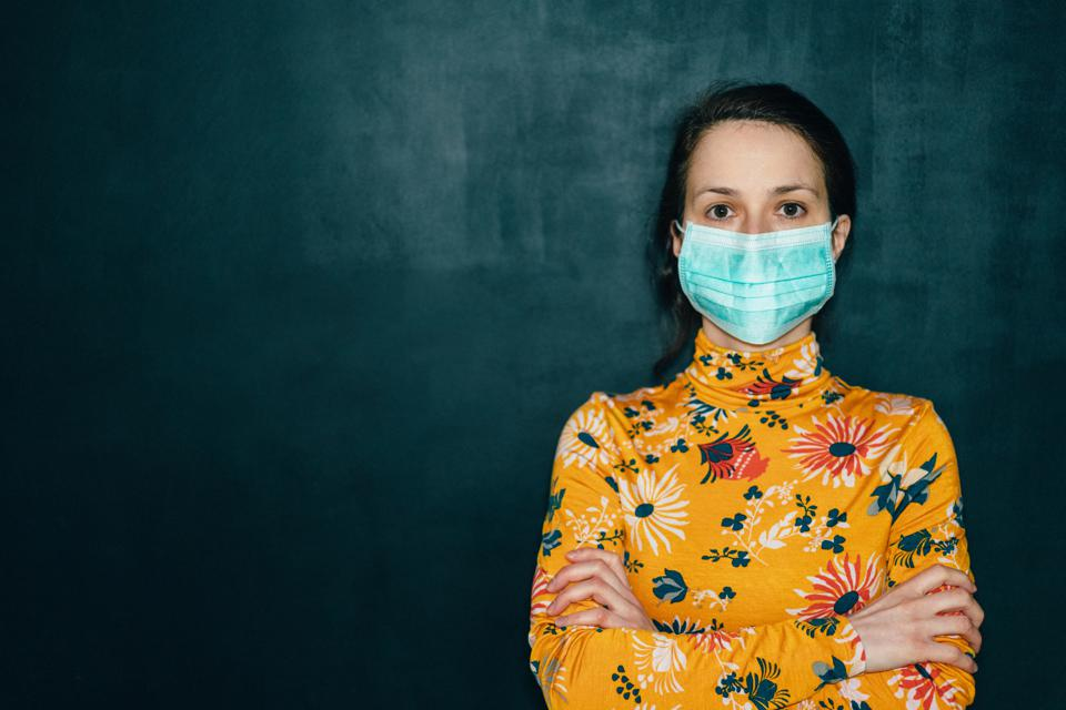 Woman wearing protective face mask during COVID-19 pandemic