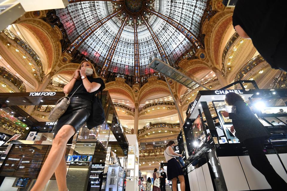 Shoppers wearing masks a Paris luxury department store Galeries Lafayette