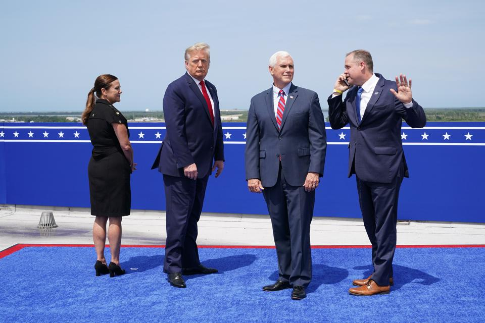 Bridenstine from NASA standing next to Mike Pence, Donald Trump, and Karen Pence.