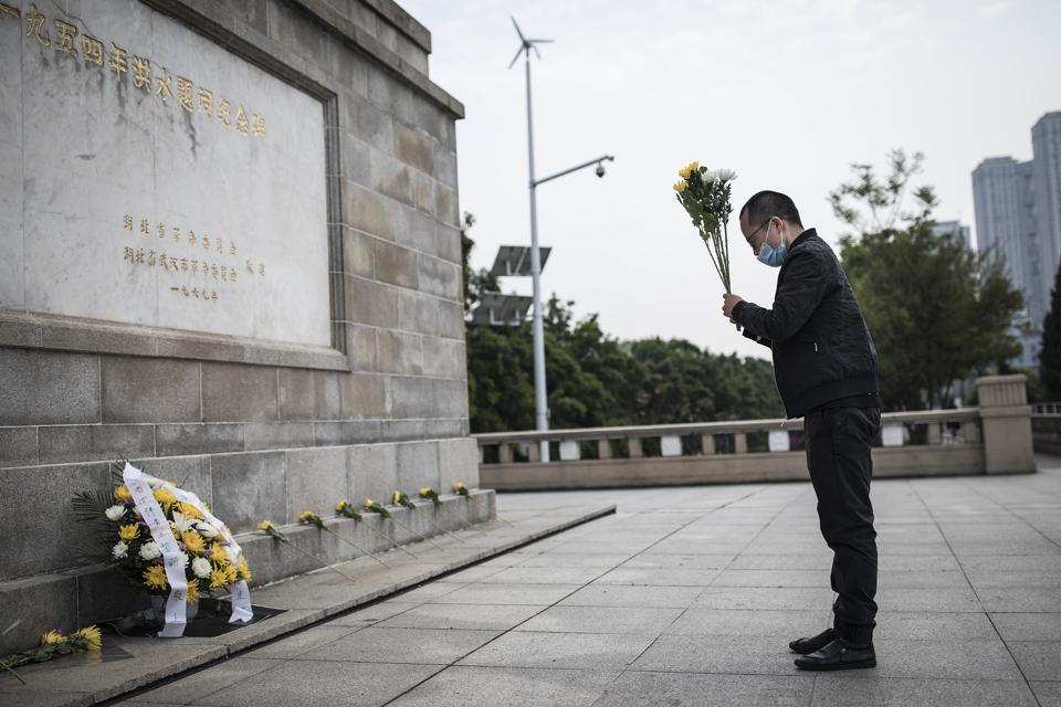 Photos: Wuhan Mourns Coronavirus Victims On Tomb Sweeping Day