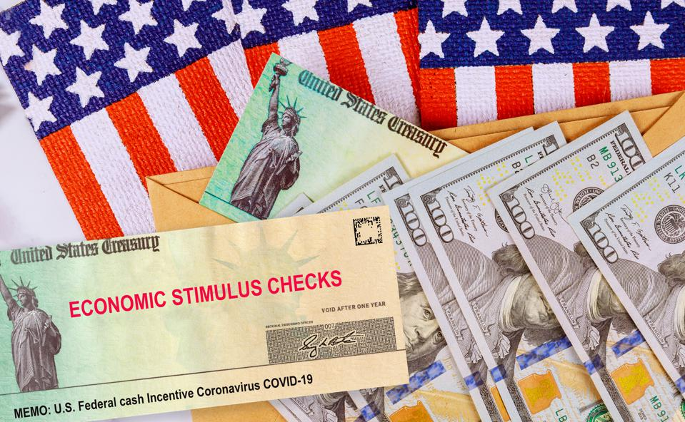 Stimulus financial a bill individual checks from government US 100 dollar bills currency American flag Global pandemic Covid 19 lockdown