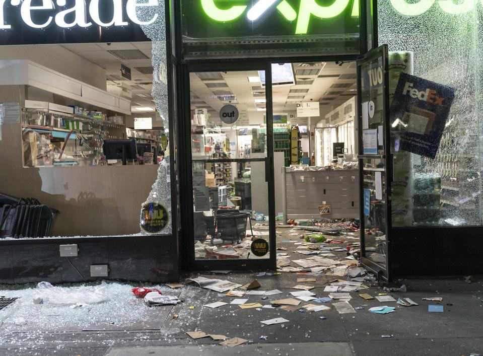 View of Duane Reade Pharmacy store broken windows and looted...