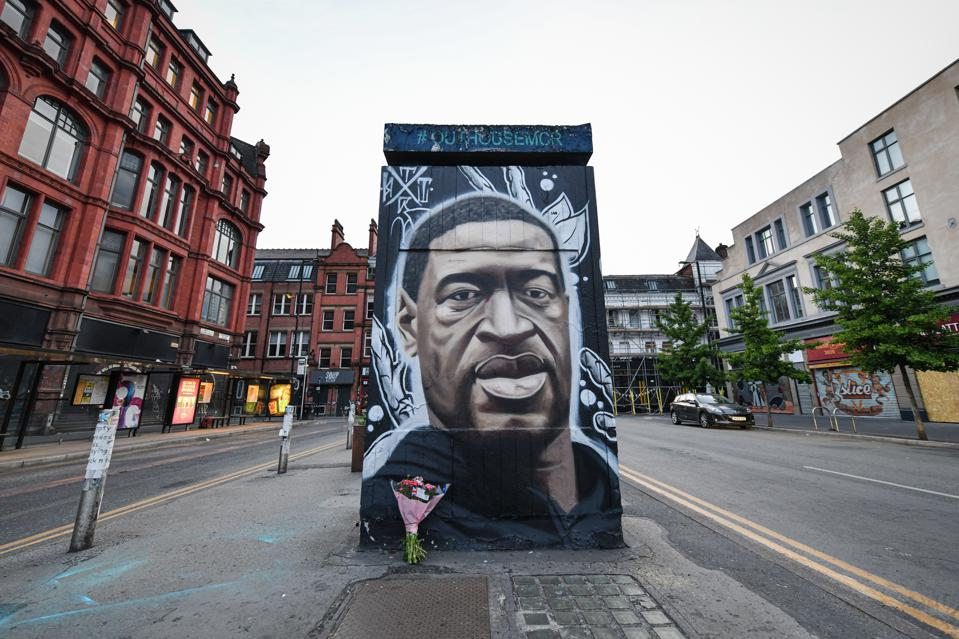 A freshly painted mural of the late George Floyd, has been...