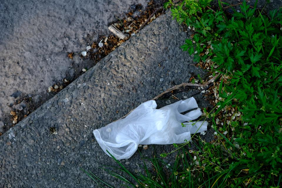 A used latex glove is abandoned as rubbish on a street floor on April 06, 2020 in Milan, Italy.