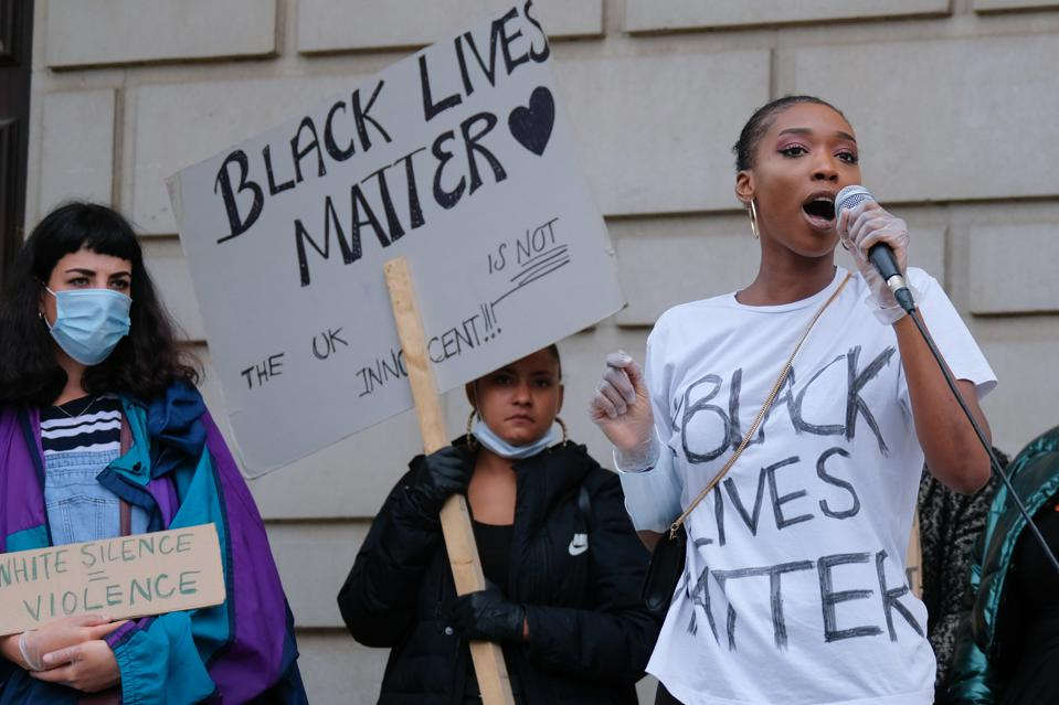 A BLM activist speaks to the crowd during a peaceful demonstration.