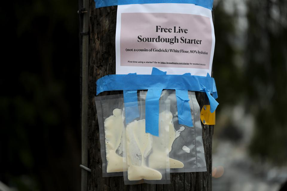 Packages of sourdough bread starter hang from a telephone pole on April 08, 2020 in San Francisco, California.
