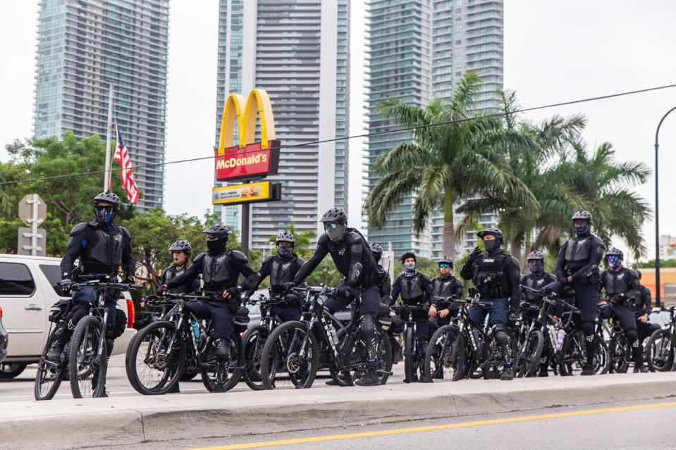 A group of bicycle police stand alert on the Biscayne...