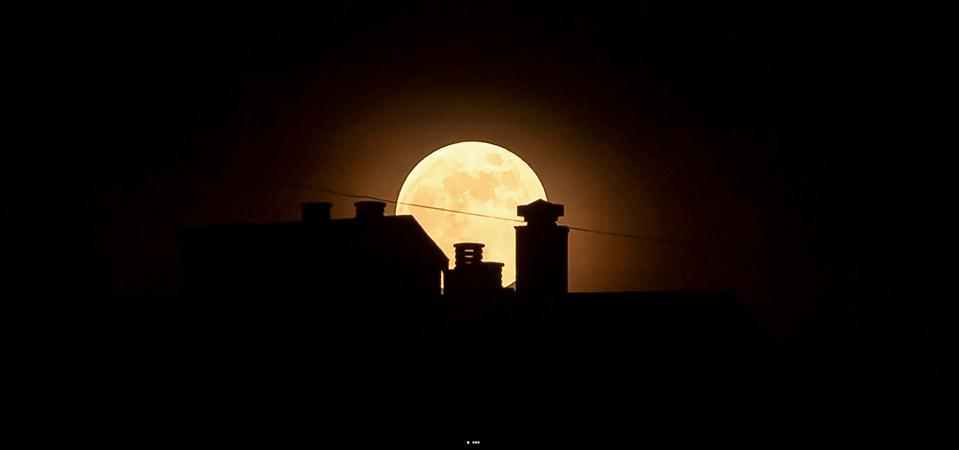The strawberry full moon, as part of a penumbral lunar...