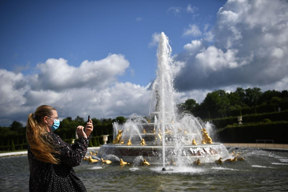 A woman visits Chateau de Versailles near Paris, for its reopening day on June 6, 2020 after weeks of closure following the lockdown measures.
