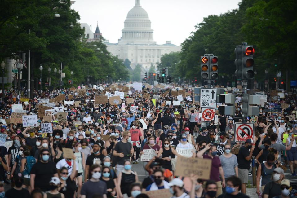 WASHINGTON, DC - JUNE 6: Civil rights advocates march in Washin