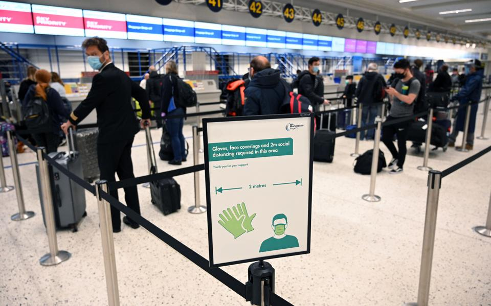 People queue at Heathrow arrivals as quarantine rules come into effect in the UK
