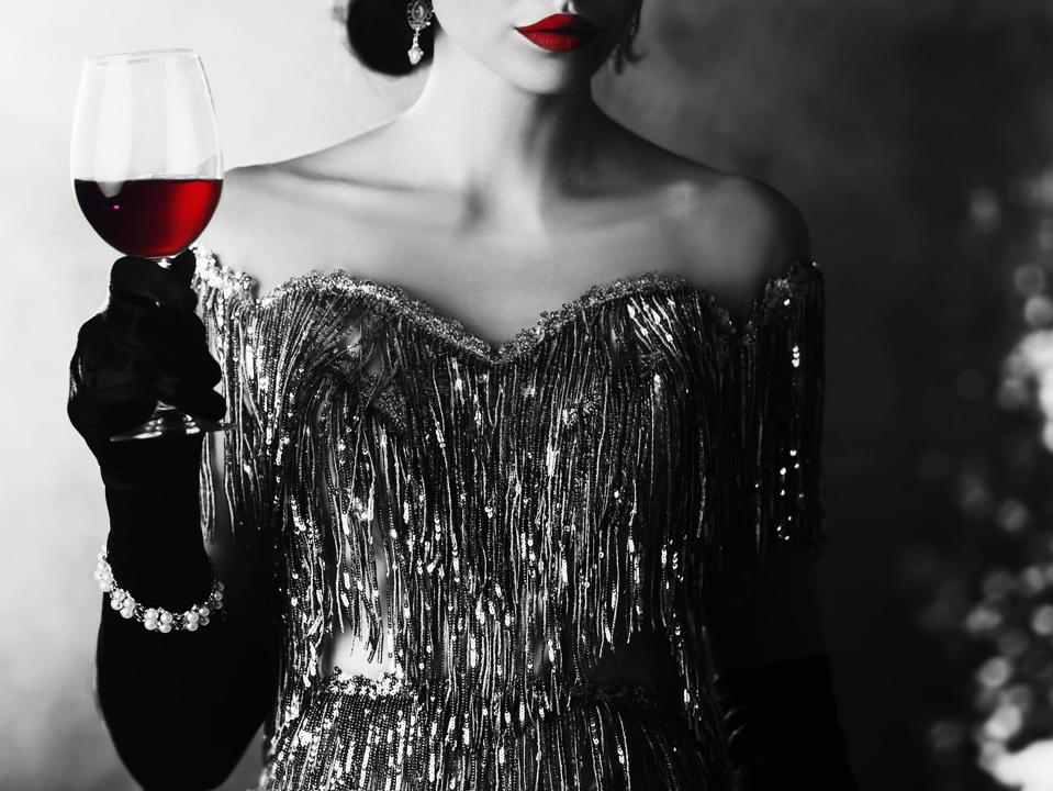 Woman Dressed in 1920s Style with a Glass of Wine