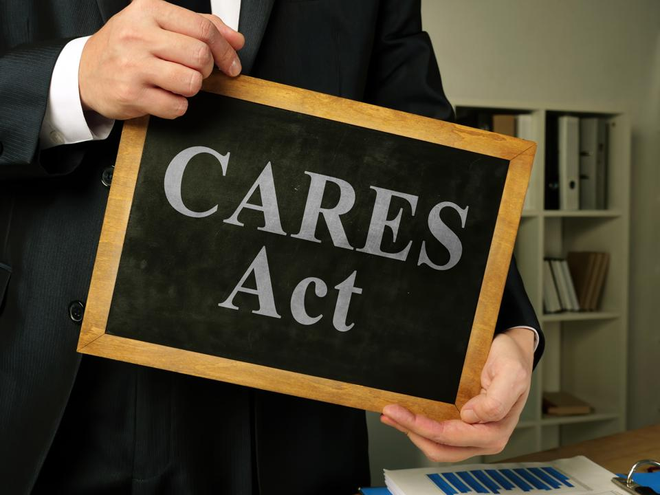 Coronavirus Aid, Relief, and Economic Security CARES Act in the lawyer hands.