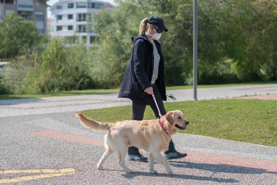 Women walking with her dog in park