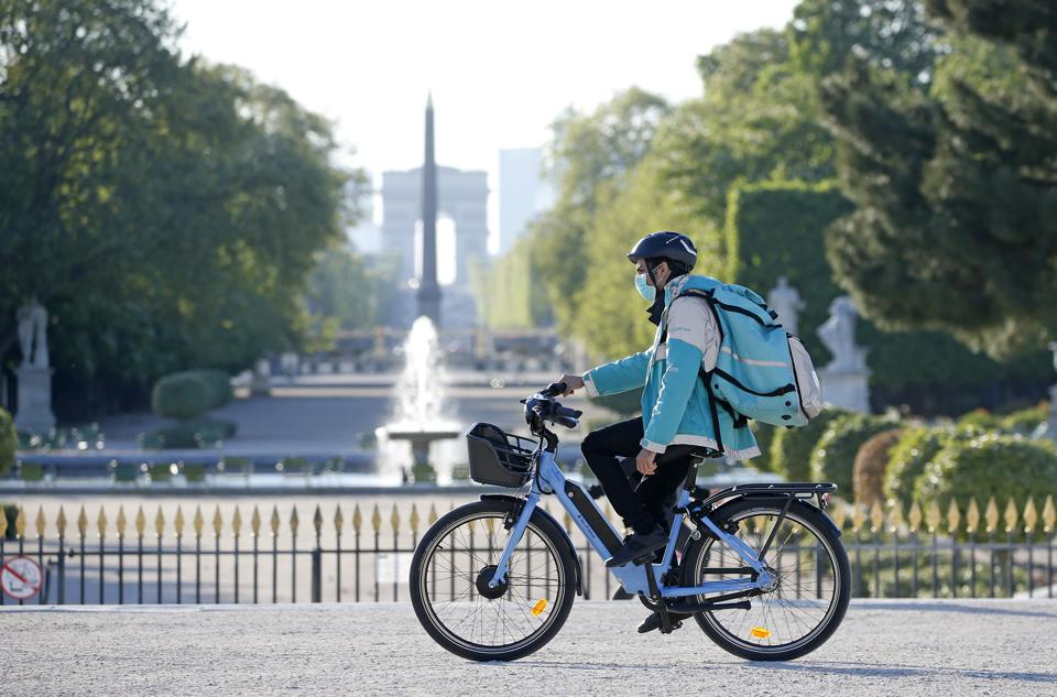 A Deliveroo cyclist in the Jardin des Tuileries on April 15, 2020, in Paris, France.