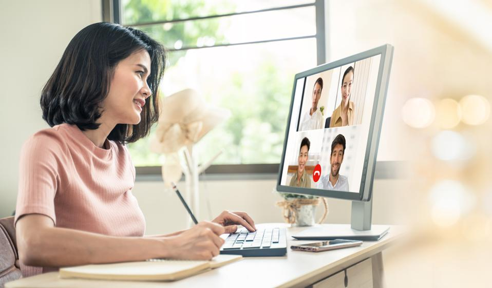 Business woman talking to colleague team about plan in video conference. Group of multiethnic business people using computer for online meeting in video call conference. Smart working from home.