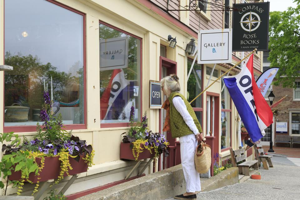 Main Street shops and shoppers in a small New England town, Castine, Maine, USA
