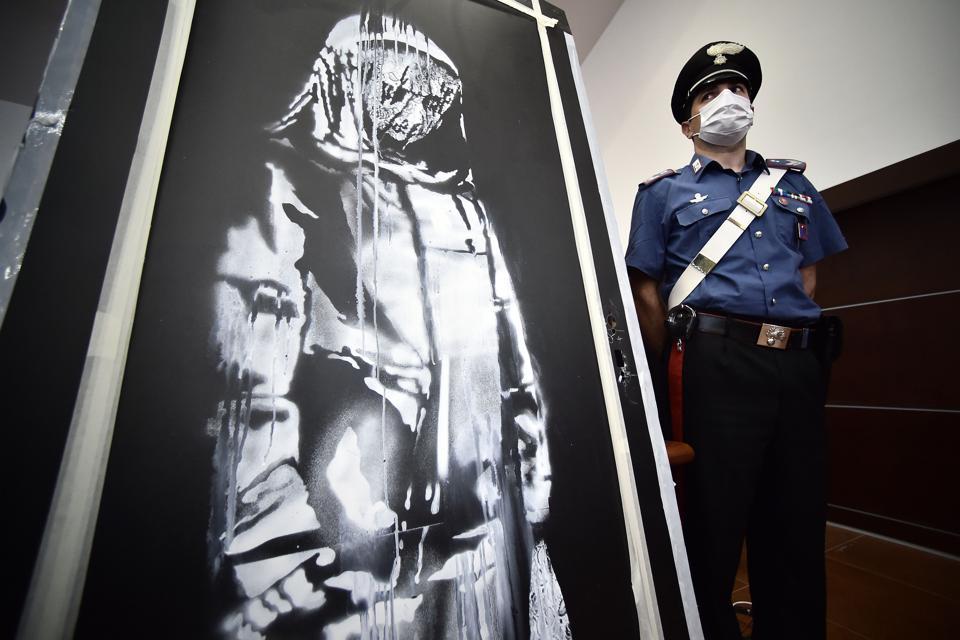 ITALY-FRANCE-STREET ART-POLICE