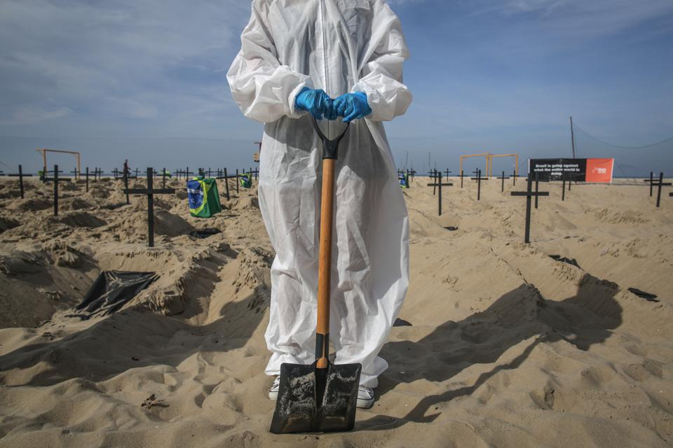 NGO Digs Symbolic Graves in the Sand in Copacabana Beach to Protest Against the Federal Government's Actions During the Coronavirus (COVID - 19) Pandemic