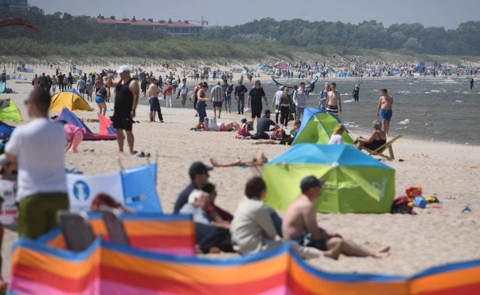 tourists on beach as Poland reopens its borders to EU countries