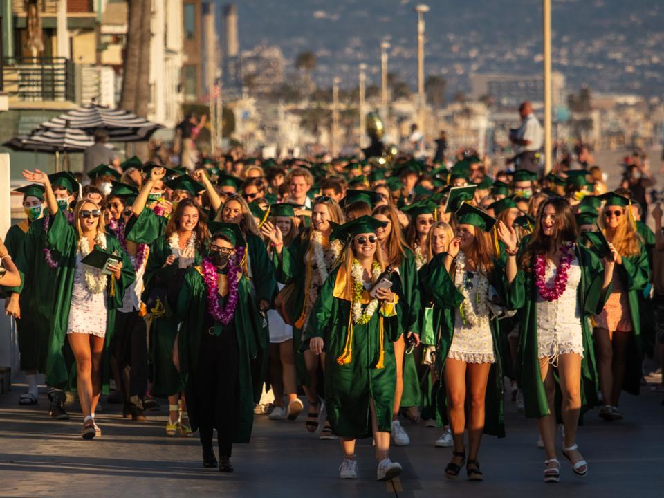 Graduates in cap and gown from Mira Costa High School, celebrate at Manhattan Beach Pier Covid-19 coronavirus