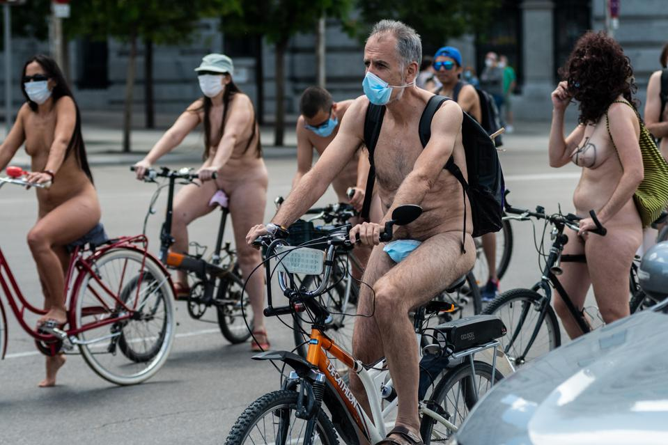 (EDITORS NOTE: Image contains nudity). Naked cyclist wearing...