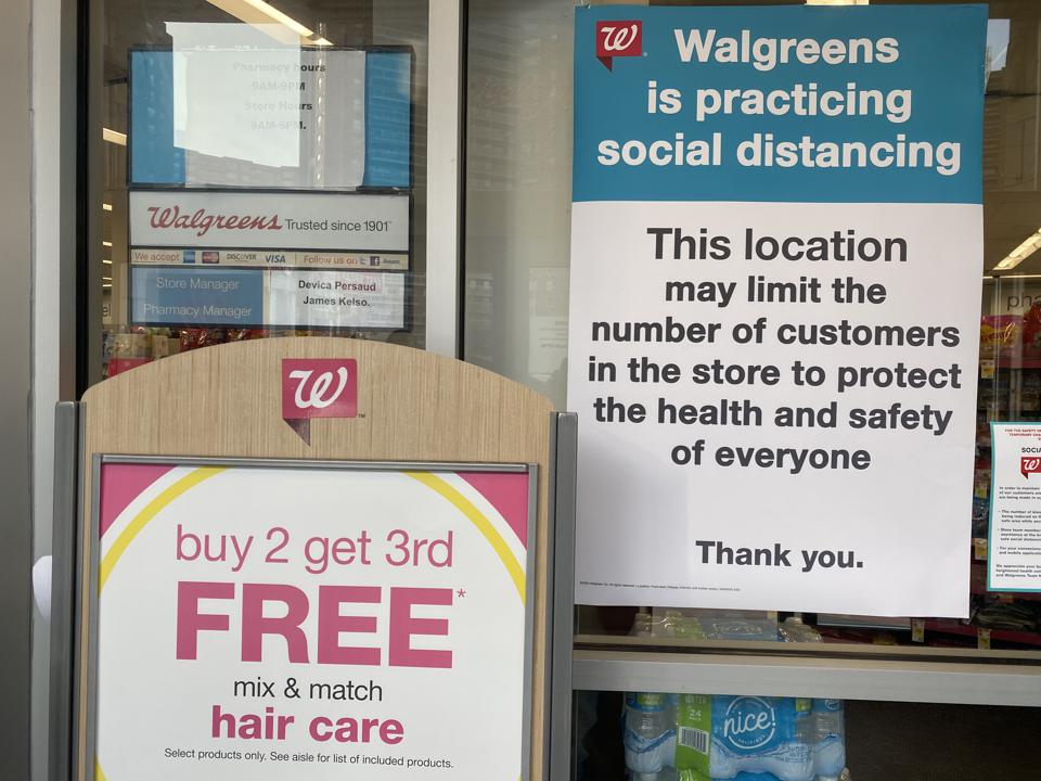 Sign, This location practicing Social Distancing, Walgreens