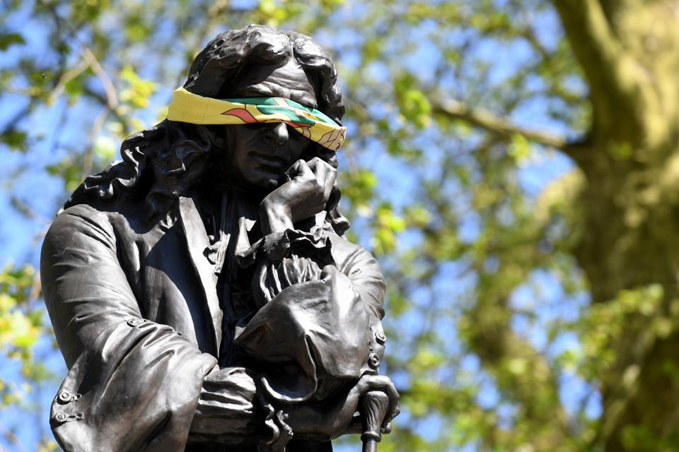 The statue to Edward Colston, a slave trader, is seen with a blindfold in Bristol, United Kingdom,