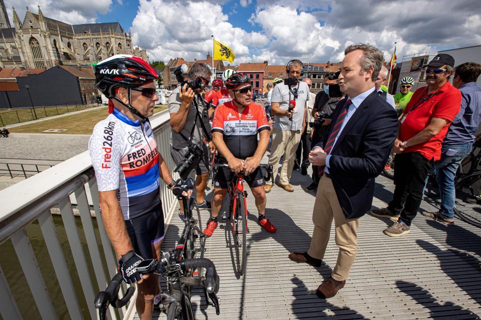 French official Jean-Baptiste Lemoyne talks to cyclist on France Belgium border
