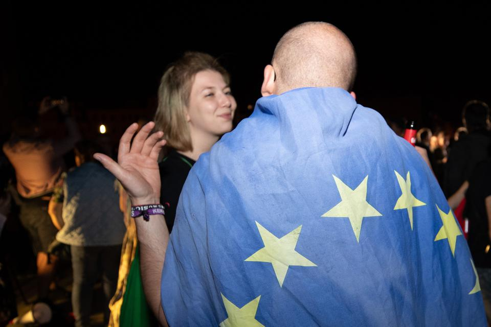 Man wearing EU flag as Poland opens its borders to travelers from European Union countries